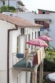 Balcony with umbrella — Stock Photo