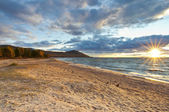 Sunset beach. Baikal. — Stock Photo