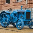 Old blue tractor - Stock Photo