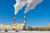 River embankment and electricity plant in winter — Stock Photo
