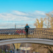 Woman on the bridge — Stock Photo