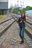 Girl at railroad — Stock Photo