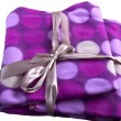 Plaid cashmere blanket colored gift wrap flying colorful circles — Stock Photo #15456865