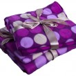 Plaid cashmere blanket colored gift wrap flying colorful circles — Stock Photo #15456951