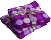 Plaid cashmere blanket colored gift wrap flying colorful circles — Stock Photo