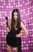 Meisje met een microfoon — Stockfoto