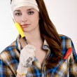 Girl and screwdriver — Stock Photo #23630365