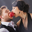 Boy and girl biting  apple — Stock Photo