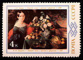 Stamps with the image of Portrait of a Woman with Flowers and Fruit — Stok fotoğraf