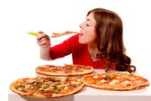 Girl tries three kinds of pizza — Stock Photo