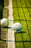 Balls on the soccer field — Stock Photo