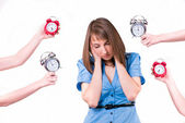 Girl and a lot of alarm clocks — Stock Photo