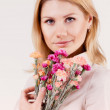 Girl with a bouquet of flowers — Stock Photo
