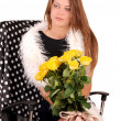 Stock Photo: Girl with a bouquet of yellow roses