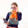 Descend little girl with glasses encyclopedia — Stock Photo #25571471
