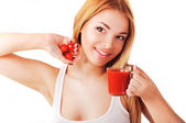 Girl with tomato and tomato juice — Stock Photo