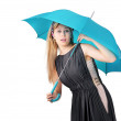 Girl peeking out under umbrella — Stock Photo #26562941