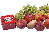 Peaches and grapes with box — Stock Photo