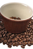 Coffee beans in brown cup — Stock Photo