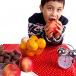 Stock Photo: Boy eating an apple