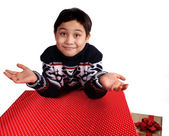 Boy hiding gift — Stock Photo