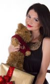 Lovely woman in black dress with teddy bear — Stock Photo