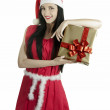 New Year Christmas girl dressed as Santa santa suit brunette in a red dressa gift from a girl a gift from a girl in santa kosyume an unexpected gift a gift from her — Stock Photo #36644827