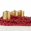 Stock Photo: Beautifulcandle bead three bright beautiful juicy contrasting intimate holidays for atmosphere date raslablenie glamor sought Elegance red gold three gold candles red beads
