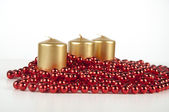 Beautifulcandle bead three bright beautiful juicy contrasting intimate holidays for the atmosphere date raslablenie glamor sought Elegance red gold three gold candles red beads — Stock Photo