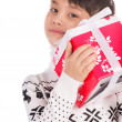 Smiling little boy with small Christmas gift box — Stock Photo