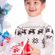 Smiling little boy with small Christmas gift box — Stock Photo #38460067
