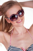 Beautiful sexy blonde in a bathing suit and sunglasses — Stock Photo