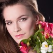Stock Photo: Beautiful womface with flower
