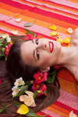 Beautiful woman face with a flower — Stock Photo