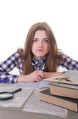 Schoolgirl is tired of studying — Stock Photo