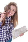 Schoolgirl holding a magnifying glass and map — Foto de Stock