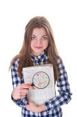 Schoolgirl holding a magnifying glass and map — Foto Stock