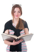 Beautiful schoolgirl holding a book in her hands — Stock Photo
