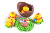 Chocolate eggs and chicks in them — Stock Photo