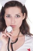 Ragazza in tuta conventionalized sessuale del medicina infermiere — Foto Stock