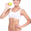 Young beautiful woman with green apple isolated over white backg - Stock Photo