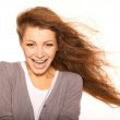 Portrait of cheerful Caucasian female smiling over white backgro - Stock Photo