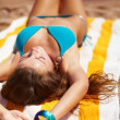Young beautiful woman relaxing at beach - Stock fotografie