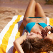 Young beautiful woman relaxing at beach - Foto de Stock