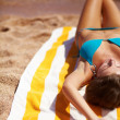 Young beautiful woman relaxing at beach - Stockfoto