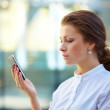Royalty-Free Stock Photo: Pretty young business woman using mobile phone