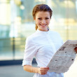 Portrait of young beautiful business woman with newspaper - Stock Photo