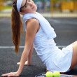 Young female tennis player having a rest after tenis - Photo