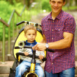 Father with son and a bicycle - Stock Photo
