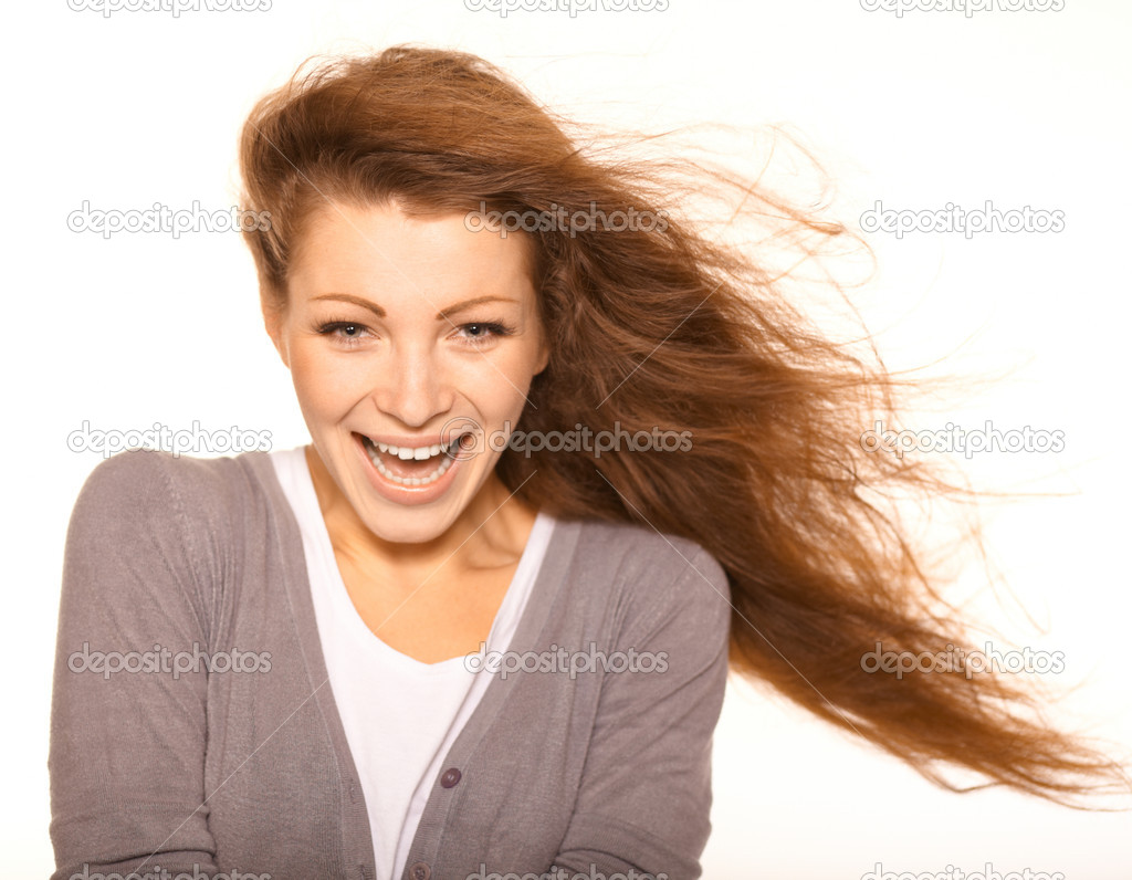 Portrait of cheerful Caucasian female smiling over white background with surprised expression — Stock Photo #12473180